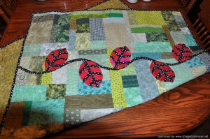 11 - Ode to Freddy - needs hand quilting on the leaves and stem  I am hand quilting phobic but I am determined to do big stitch quilting on this one.