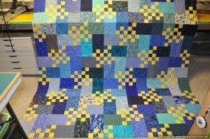 6 - Singing the Blues - this one is now quilted although this picture shows it at the flimsy stage.  Just needs the binding now.